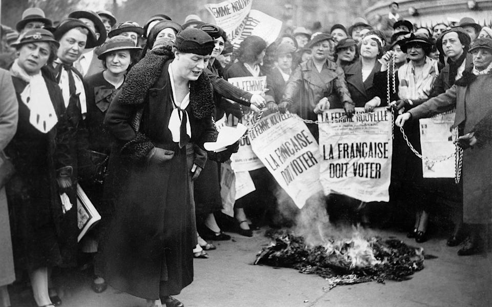 FRANCE - MAY 30:  Suffragettes belonging to LA FEMME NOUVELLE movement (THE NEW WOMAN) and led by Louise WEISS symbolically burned their chains at Bastille Square in Paris while waving signs on which were written
