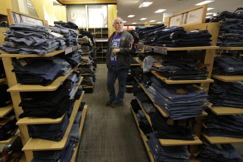 FILE - In this Nov. 29, 2019, file photo Tim Simpson shops at a Kohl's store in Colma, Calif. On Friday, Dec. 13, the Commerce Department releases U.S. retail sales data for November. (AP Photo/Jeff Chiu, File)