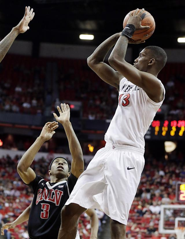 UNLV's Kevin Olekaibe covers a shot from San Diego State's Winston Shepard during the second half of an NCAA college basketball game in the semifinals of the Mountain West Conference tournament Friday, March 14, 2014, in Las Vegas. San Diego State defeated UNLV 59-51. (AP Photo/Isaac Brekken)