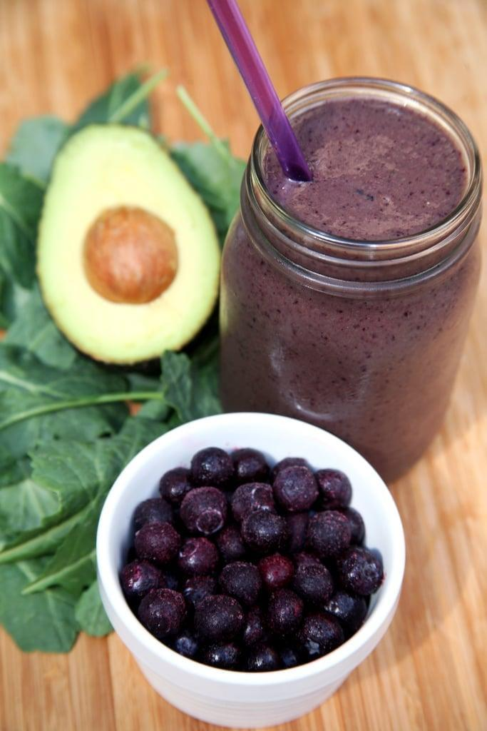 """<p>To increase the fiber and up the vitamins in your smoothie, throw in a big bunch of baby spinach or kale (fresh or <a href=""""https://www.popsugar.com/fitness/How-Freeze-Greens-34083499"""" class=""""link rapid-noclick-resp"""" rel=""""nofollow noopener"""" target=""""_blank"""" data-ylk=""""slk:frozen"""">frozen</a>). Added fiber will not only help you stay full, but it can also prevent constipation which won't help you lose weight, but will make your belly look flatter and less bloated. </p> <p>Mix up this <a href=""""https://www.popsugar.com/fitness/Kale-Protein-Smoothie-43438164"""" class=""""link rapid-noclick-resp"""" rel=""""nofollow noopener"""" target=""""_blank"""" data-ylk=""""slk:blueberry kale avocado protein smoothie"""">blueberry kale avocado protein smoothie</a> that offers 10 grams of fiber.</p>"""