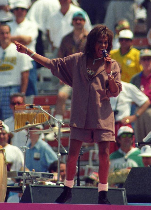 Pop singer Whitney Houston performs during closing ceremonies at the Rose Bowl in Pasadena July 17, 1994 prior to the World Cup final match between Brazil and Italy. Italy and Brazil last played in a World Cup final in 1970, with Pele leading the Brazilians to a 4-1 victory. REUTERS/Gary Hershorn