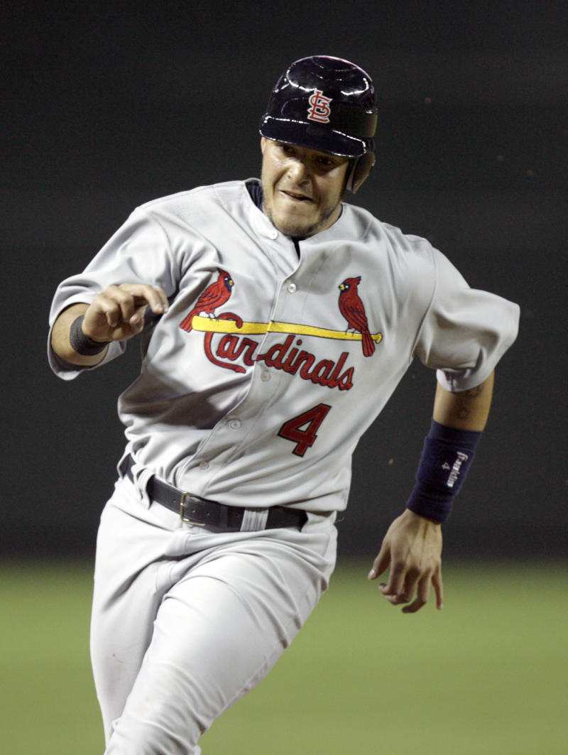 St. Louis Cardinals' Yadier Molina sprints around third base to score a run on a double by Kyle McClellan against the Arizona Diamondbacks in the third inning of a baseball game Monday, April 11, 2011, in Phoenix. (AP Photo/Paul Connors)