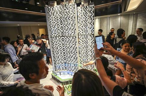 Potential buyers examining Wheelock Properties' sales launch of 318 flats at the Marini and Grand Marini projects in Lohas Park on 11 September 2019. Photo: Winson Wong