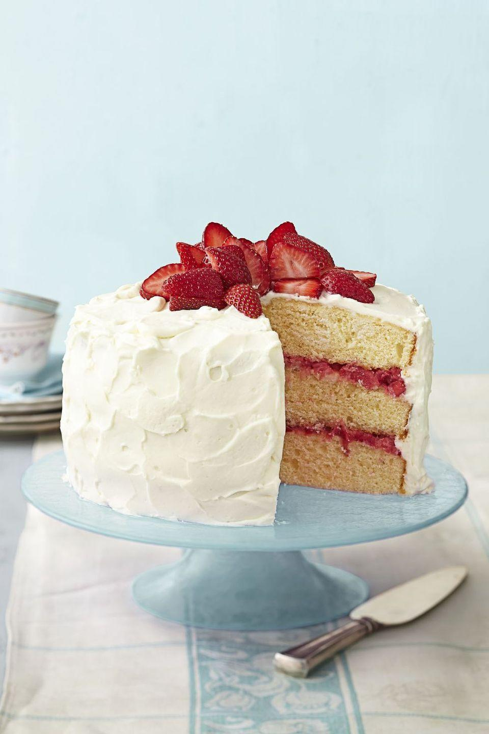 """<p>Even with sweet cream cheese frosting and light and fluffy vanilla cake, it's the fruity rhubarb compote that steals the show with this dessert. Top with some blueberries for a red, white and blue twist.</p><p><em><a href=""""https://www.goodhousekeeping.com/food-recipes/a15071/strawberry-rhubarb-layer-cake-recipe-ghk0414/"""" rel=""""nofollow noopener"""" target=""""_blank"""" data-ylk=""""slk:Get the recipe for Strawberry Rhubarb Layer Cake"""" class=""""link rapid-noclick-resp"""">Get the recipe for Strawberry Rhubarb Layer Cake</a> <em><a href=""""https://www.goodhousekeeping.com/food-recipes/a10121/cupcake-flag-berries-coconut-ghk0710/"""" rel=""""nofollow noopener"""" target=""""_blank"""" data-ylk=""""slk:»"""" class=""""link rapid-noclick-resp"""">»</a></em></em></p>"""