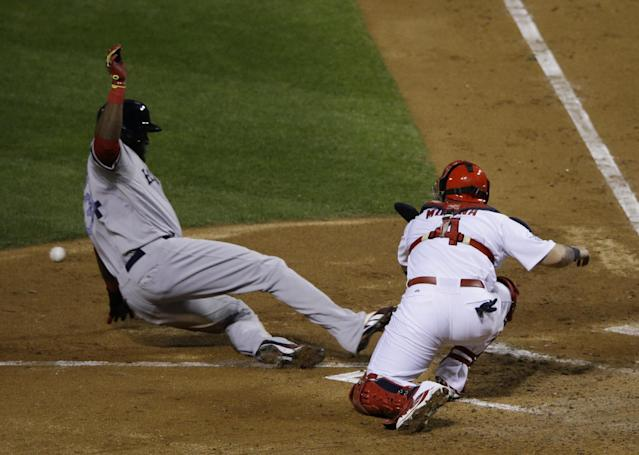 Boston Red Sox designated hitter David Ortiz slides safely past St. Louis Cardinals catcher Yadier Molina during the fifth inning of Game 4 of baseball's World Series Sunday, Oct. 27, 2013, in St. Louis. Ortiz scored on a sacrifice fly by Stephen Drew. (AP Photo/Charlie Neibergall)