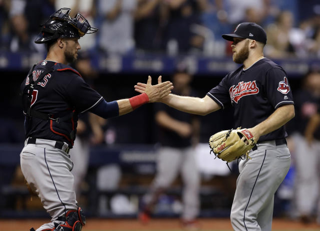 Cleveland Indians pitcher Cody Allen, right, celebrates with catcher Yan Gomes after Allen closed out the Tampa Bay Rays during the ninth inning of a baseball game, Tuesday, Sept. 11, 2018, in St. Petersburg, Fla. Cleveland won the game 2-0. (AP Photo/Chris O'Meara)