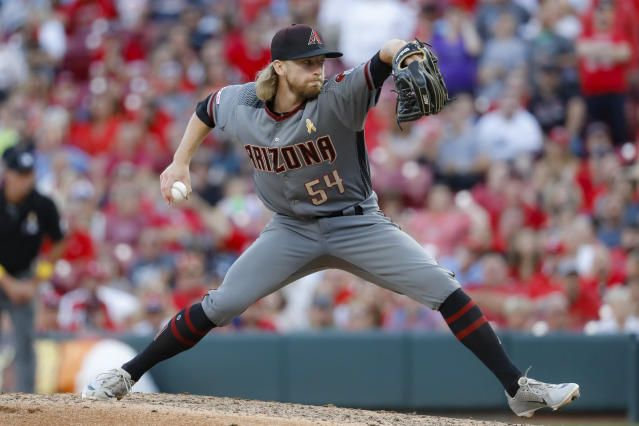 Arizona Diamondbacks relief pitcher Jimmie Sherfy throws in the ninth inning of a baseball game against the Cincinnati Reds, Saturday, Sept. 7, 2019, in Cincinnati. (AP Photo/John Minchillo)
