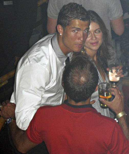 """In this June 2009 photo made available to the Associated Press on Friday Oct. 5, 2018, soccer star Cristiano Ronaldo is pictured with Kathryn Mayorga in Rain Nightclub in Las Vegas. A lawyer for Mayorga, who is alleging that Ronaldo raped her in Las Vegas in 2009 said her client was """"emotionally fragile"""" and agreed to an out-of-court financial settlement nine years ago because then she never wanted her name made public. Mayorga filed a lawsuit last week in state court seeking to void the agreement she signed while accepting $375,000 to keep quiet about the alleged encounter. (Matrixpictures via AP) NO SALES NO ARCHIVE MANDATORY CREDIT"""