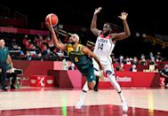 <p>Patty Mills of Australia is fouled by Draymond Green of the USA during the Basketball semi final match between Australia and the USA on day thirteen of the Tokyo 2020 Olympic Games at Saitama Super Arena on August 05, 2021 in Saitama, Japan. (Photo by Bradley Kanaris/Getty Images)</p>