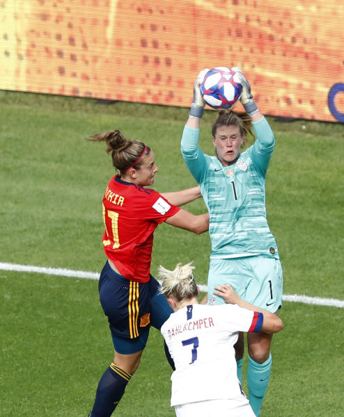 United States goalkeeper Alyssa Naeher, right, makes a save in front of Spain's Alexia Putellas, left, during the Women's World Cup round of 16 soccer match between Spain and United States at Stade Auguste-Delaune in Reims, France, Monday, June 24, 2019. (AP Photo/Thibault Camus)