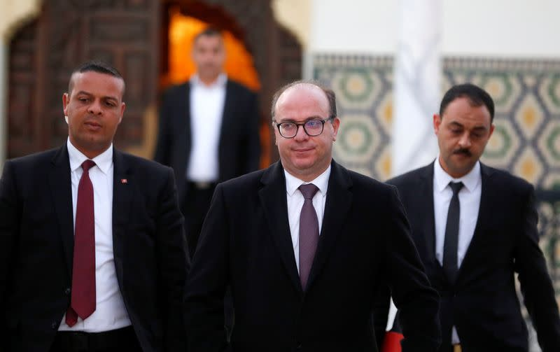 Tunisian Prime Minister Elyes Fakhfakh leaves for a meeting with Tunisian President Kais Saied in Tunis