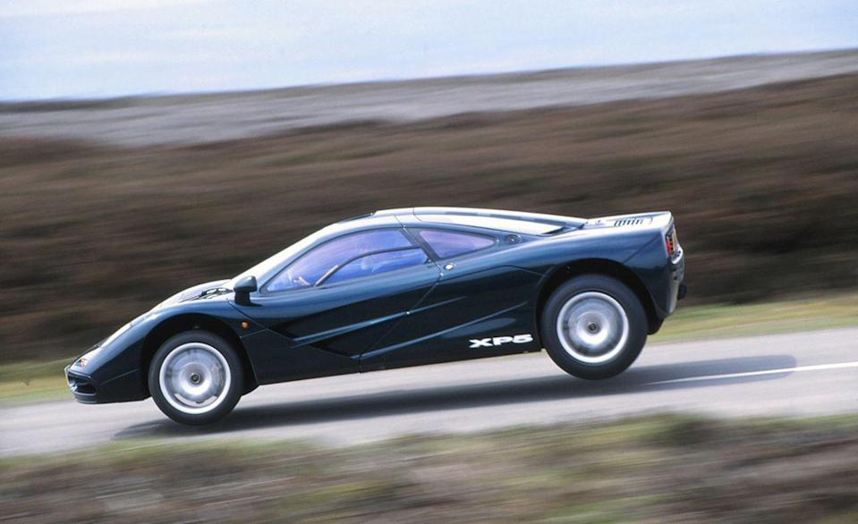 """<p>Today, McLaren's F1 is looked to as a watershed moment in supercar performance with escalating values to match. Back in 1994 when <a href=""""http://www.caranddriver.com/reviews/mclaren-f1-supercar-road-test-review"""" rel=""""nofollow noopener"""" target=""""_blank"""" data-ylk=""""slk:we tested one"""" class=""""link rapid-noclick-resp"""">we tested one</a>, it was merely the newest hot thing, even if we already knew it would reach icon status. That's not to say we intentionally set out to jump the F1, but sometimes unexpected stuff happens at speeds above 100 mph on unfamiliar roads. A hump in the pavement was all it took to send the F1 skyward.</p>"""
