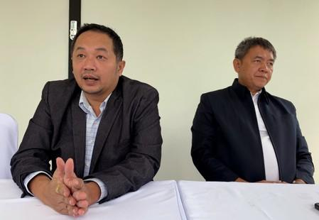 "Sattra Toaon (left) and Songklod ""Pukem"" Chuenchoopol, founders of Right wing group, the Thai Wisdom Guard talk to Reuters in Nonth"