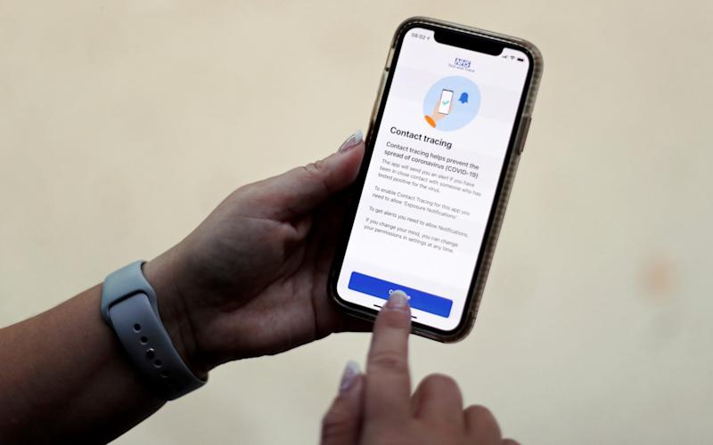 The coronavirus disease (COVID-19) contact tracing smartphone app of Britain's National Health Service (NHS) is displayed on an iPhone in this illustration photograph taken in Keele, Britain - Carl Recine/Reuters