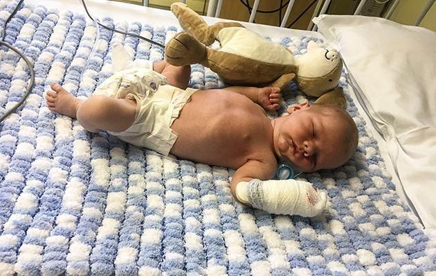 Gunner was just nine-days-old when he was rushed to hospital. Photo: Caters News