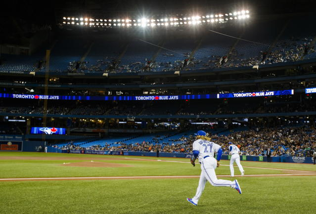 Toronto Blue Jays rookie Vladimir Guerrero Jr. takes the field for his major league debut against the Oakland Athletics during the first inning of baseball game action in Toronto, Friday, April 26, 2019. (Mark Blinch/The Canadian Press via AP)