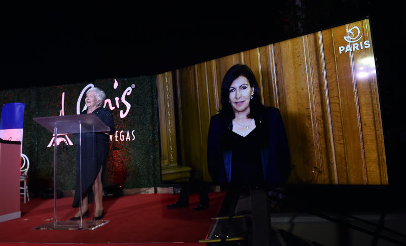 French actress and singer Line Renaud presents a video greeting from Mayor Anne Hidalgo of Paris, France at the debut of the new Eiffel Tower lights at Paris Las Vegas. (Courtesy of Paris Las Vegas)