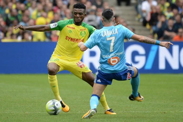 Nantes' defender Chidozie Awaziem (L) vies with Marseille's French midfielder Remy Cabella during the French L1 football match between Nantes and Olympique de Marseille on August 12, 2017