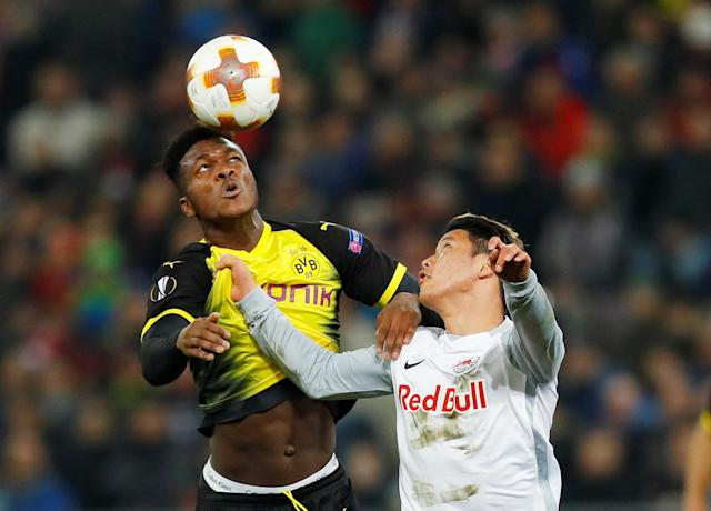Soccer Football - Europa League Round of 16 Second Leg - RB Salzburg vs Borussia Dortmund - Red Bull Arena Salzburg, Salzburg, Austria - March 15, 2018 Borussia Dortmund's Dan-Axel Zagadou in action with RB Salzburg's Hwang Hee-chan REUTERS/Leonhard Foeger