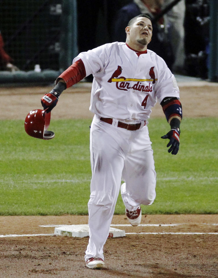 St. Louis Cardinals' Yadier Molina reacts after flying out against the Texas Rangers during the first inning of Game 7 of baseball's World Series Friday, Oct. 28, 2011, in St. Louis. (AP Photo/Jeff Roberson)