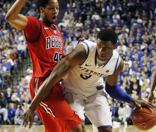 Kentucky's Terrence Jones, right, looks for an opening against Mississippi's Jelan Kendrick during the second half of an NCAA college basketball game in Lexington, Ky., Saturday, Feb. 18, 2012. Kentucky won 77-62. (AP Photo/James Crisp)