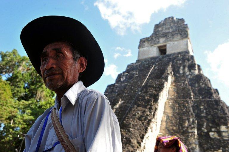 A Guatemalan Maya native visits the Tikal archaeological site on December 20, 2012