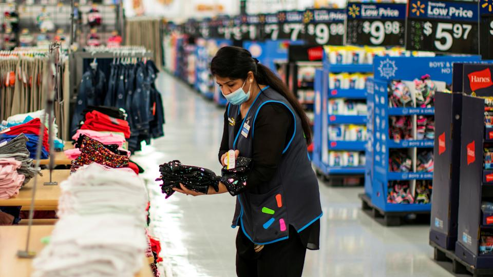 A worker is seen wearing a mask while organizing merchandise at a Walmart store, in North Brunswick, New Jersey, U.S. July 20, 2020. REUTERS/Eduardo Munoz