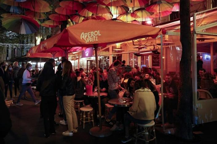Bars in Paris have continued to draw large crowds of people often flouting physical distancing and mask-wearing guidelines