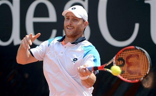 Michael Berrer of Germany returns a ball to Jeremy Chardy from France, during the round of 16 match of the Mercedes Cup ATP tennis tournament in Stuttgart, Germany, Wednesday July 10, 2013. (AP Photo/dpa, Marijan Murat)