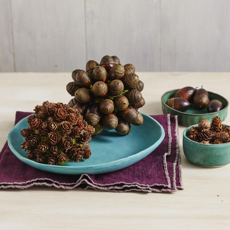 "<p>Fill any empty vase or vessel with these DIY fall moss balls for a no-fuss, natural centerpiece. Get the instructions <a href=""https://www.southernliving.com/home/fall/fall-home-decor-crafts?slide=537863#537863"">here</a>. </p>"