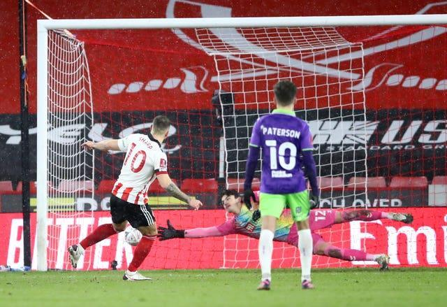 Billy Sharp's penalty took Sheffield United to the sixth round.
