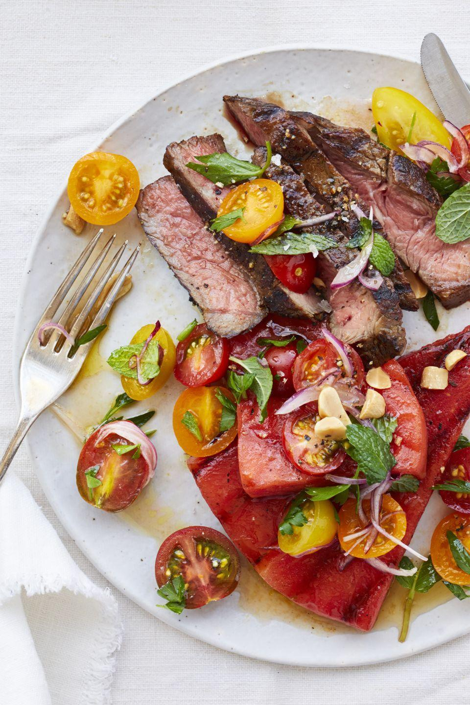 "<p>Bet you didn't think steak would make it on this list, did you? According to the <a href=""https://www.heart.org/en/healthy-living/healthy-eating/eat-smart/nutrition-basics/meat-poultry-and-fish-picking-healthy-proteins"" rel=""nofollow noopener"" target=""_blank"" data-ylk=""slk:American Heart Association"" class=""link rapid-noclick-resp"">American Heart Association</a>, you can have a moderate amount of red meat, as long as it's not everyday.</p><p><a href=""https://www.womansday.com/food-recipes/food-drinks/recipes/a59400/grilled-watermelon-salad-steak-tomatoes-recipe/"" rel=""nofollow noopener"" target=""_blank"" data-ylk=""slk:Get the Grilled Watermelon Salad with Steak and Tomatoes recipe."" class=""link rapid-noclick-resp""><em><strong>Get the Grilled Watermelon Salad with Steak and Tomatoes recipe.</strong></em></a></p>"