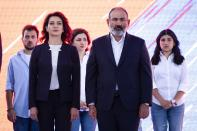 FILE In this file photo taken on Thursday, June 17, 2021, Armenian Prime Minister Nikol Pashinyan and wife Anna Hakobyan attend a rally in his support prior to upcoming parliamentary elections in the center Yerevan, Armenia. Armenians head to the polls Sunday for a snap parliamentary election stemming from a political crisis that has engulfed the former Soviet nation ever since last year's fighting over the separatist region of Nagorno-Karabakh. Acting Prime Minister Nikol Pashinyan called the early vote after facing months of protests demanding his resignation following Armenia's defeat in the Nagorno-Karbakh conflict with Azerbaijan, its neighbor in the Caucasus Mountains region south of Russia.(AP Photo/Areg Balayan, File)