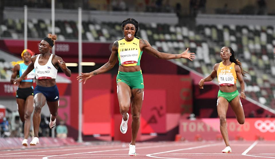 Jamaica's Elaine Thompson-Herah (C) wins the women's 200m final during the Tokyo 2020 Olympic Games at the Olympic Stadium in Tokyo on August 3, 2021. (Photo by Jewel SAMAD / AFP) (Photo by JEWEL SAMAD/AFP via Getty Images)