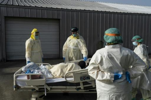 The COVID-19 pandemic has left many intensive-care units, like this one shown during a patient transfer in a Houston, Texas hospital, operating at or near capacity