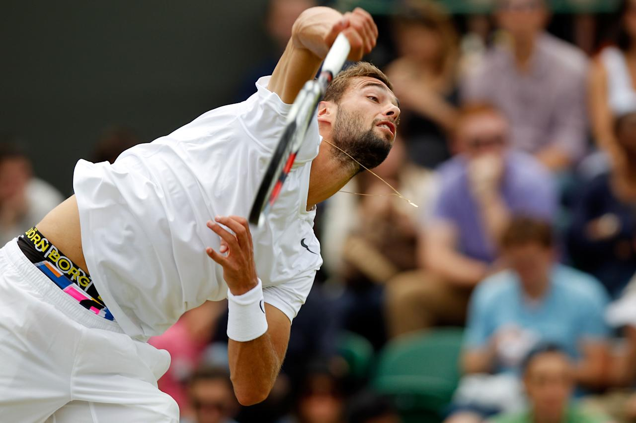 LONDON, ENGLAND - JUNE 30:  Benoit Paire of France serves during his Gentlemen's Singles third round match against  Brian Baker the USA  on day six of the Wimbledon Lawn Tennis Championships at the All England Lawn Tennis and Croquet Club at Wimbledon on June 30, 2012 in London, England.  (Photo by Paul Gilham/Getty Images)