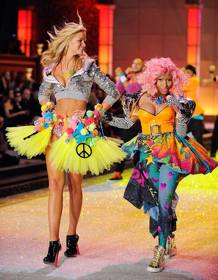 Model Erin Heatherton may tower over Nicki Minaj, but the pint-size pop star looked like she could hold her own on the catwalk during Victoria's Secret Fashion Show on Wednesday. (11/9/2011)