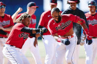 Cleveland Indians' Amed Rosario, right, celebrates with Jose Ramirez after hitting a game winning single off Chicago Cubs pitcher Keegan Thompson during the tenth inning of a baseball game, Wednesday, May 12, 2021, in Cleveland. The Indians defeated the Cubs 2-1. (AP Photo/Ron Schwane)