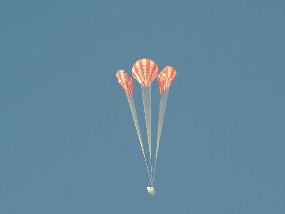 To test the Orion parachute system on May 1, 2013, engineers rigged one of the test capsule's three main parachutes – the middle parachute in this view – to skip one stage of its inflation, putting additional stress on the vehicle as it opened.