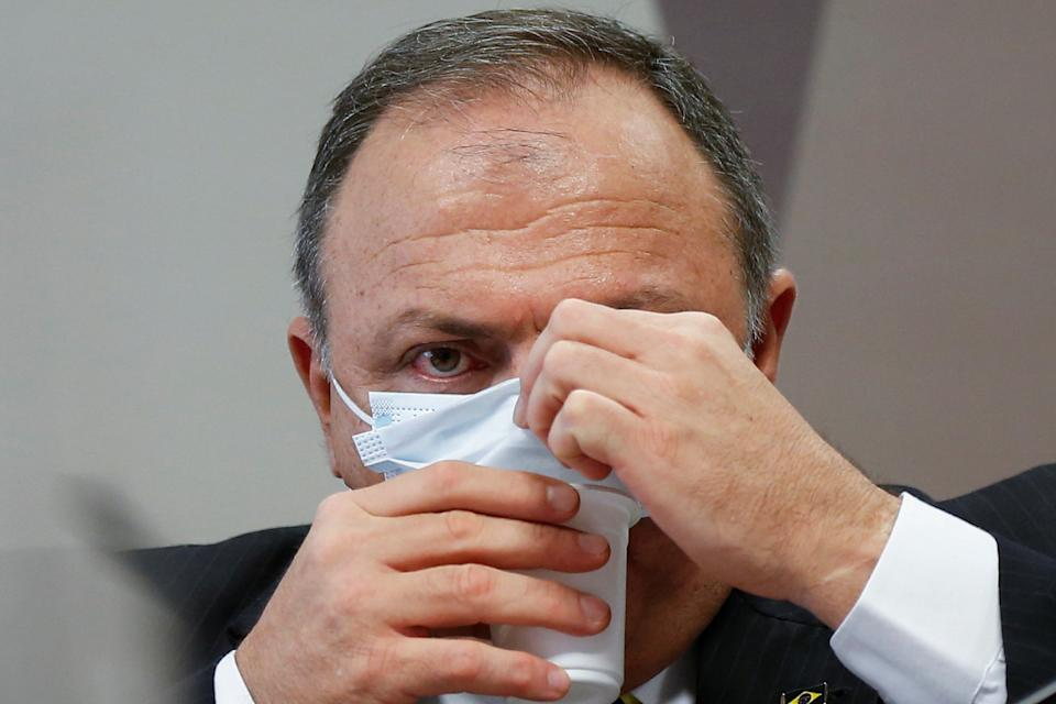 Former Brazil's Health Minister Eduardo Pazuello reacts during a meeting of the Parliamentary Inquiry Committee (CPI) to investigate government actions and management during the coronavirus disease (COVID-19) pandemic, at the Federal Senate in Brasilia, Brazil May 19, 2021. REUTERS/Adriano Machado