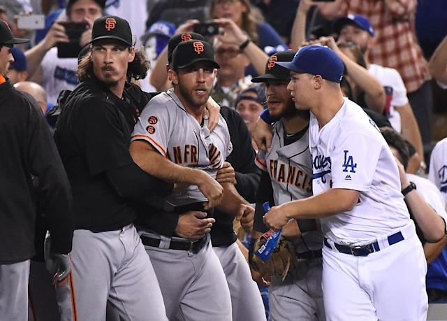 Madison Bumgarner left the game after his skirmish with Yasiel Puig. (Getty)