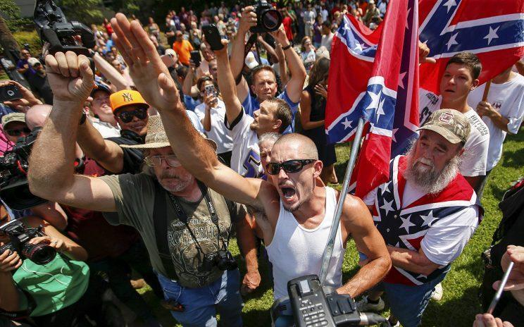 Supporters of the Ku Klux Klan and the Confederate flag yell at opposing demonstrators during a rally in Columbia, S.C., in July 2015. (Photo: Chris Keane/Reuters)