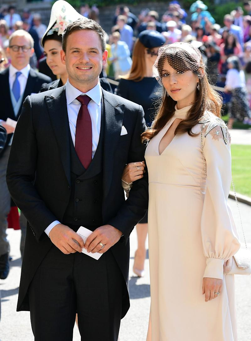 Actor Patrick J. Adams and wife Troian Bellisario arrive at St George's Chapel at Windsor Castle before the wedding of Prince Harry to Meghan Markle on May 19, 2018 in Windsor, England.
