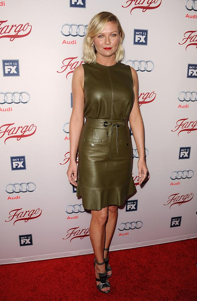 <p>The <i>Fargo</i> actress arrived to the season 2 premiere of the hit FX show in Los Angeles wearing a sleeveless leather frock with ruffled hem by the New York-based design duo. <i>Photo: Getty Images</i></p>
