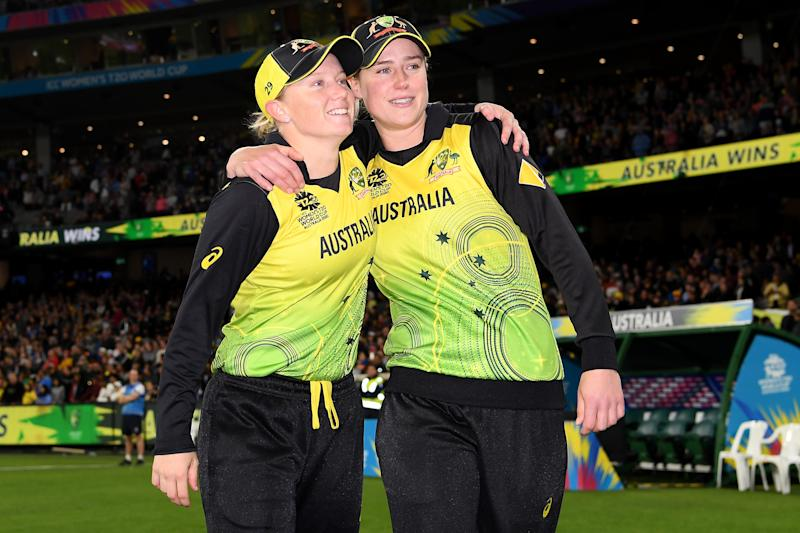 Alyssa Healy and Ellyse Perry smile after after winning the ICC Women's T20 Cricket World Cup Final.