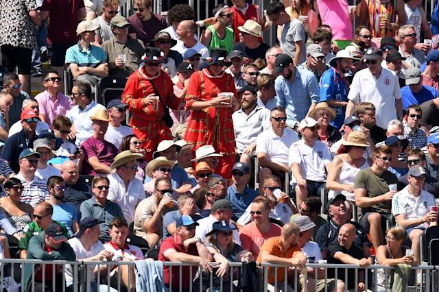 The crowd watching the fourth one-day cricket international between England and Australia in Manchester also joined in the World Cup fun, cheering loudly as every England goal went in against Panama (AFP Photo/Oli SCARFF)