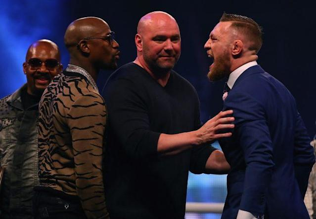 Floyd Mayweather (L) and Conor McGregor yell at one another during their Friday news conference in London. (Getty)