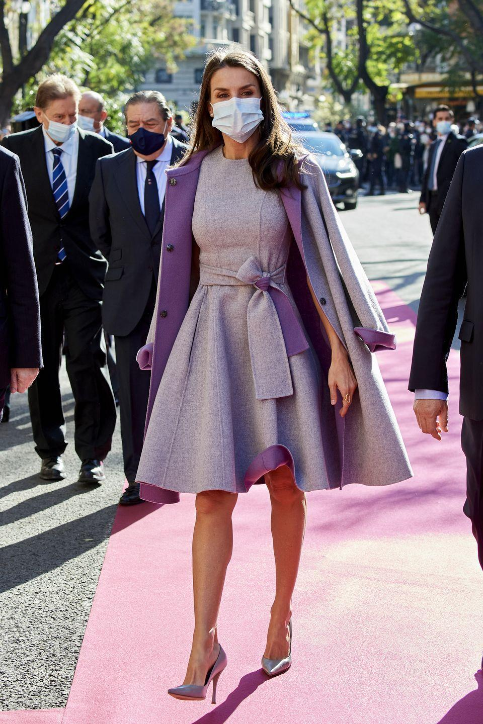 <p><strong>1 December </strong>Queen Letizia stepped out in a tailored grey dress and matching coat with regal purple accents in Valencia. </p>