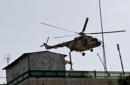 FILE PHOTO: Afghan Air forces helicopter flies over the site of a suicide attack followed by a clash between Afghan forces and insurgents during an attack on the Iraqi embassy in Kabul, Afghanistan July 31, 2017.REUTERS/Mohammad Ismail/File Photo
