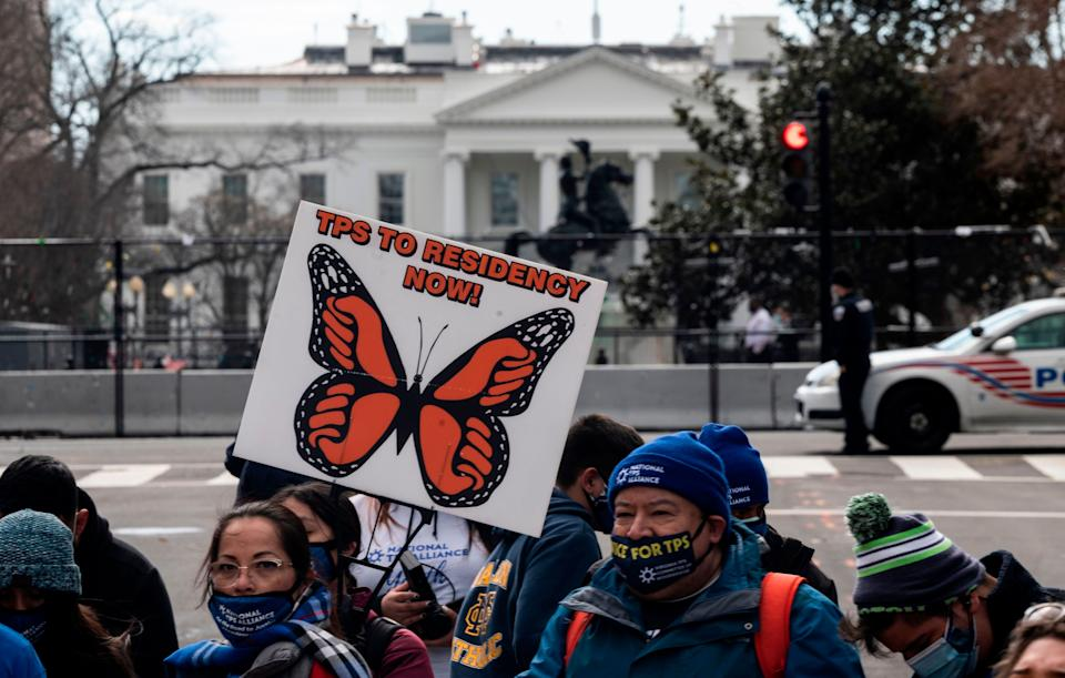 Activists and citizens with temporary protected status (TPS) march along 16th Street toward the White House in a call for Congress and the Biden administration to pass immigration reform legislation on February 23, 2021 in Washington, DC. (Photo: ANDREW CABALLERO-REYNOLDS via Getty Images)